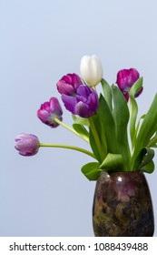 tulips in a hand-crafted vase