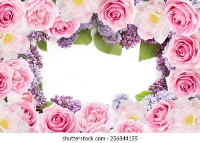 Tulips, lilac and roses flowers background isolated on white with sample text