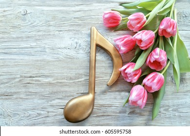 Tulips with notes on wooden background