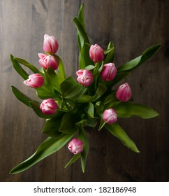 Tulips with some water splash on a wood table