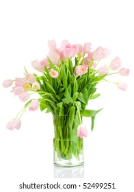 Tulips in the vase isolated on white background