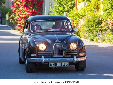 TULLGARN SWEDEN July 20, 2017. Saab 96, De luxe year 1962. Driving on a Swedish road.