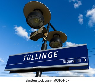 Tullinge, Sweden - August 12, 2015:: Tullinge train station with the station sign, speaker, sign show exit direction to bus, also sign for short train