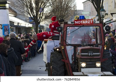 """TULLN, AUSTRIA - FEBRUARY 6, 2016:  float with the topic """"emergency doctor"""" at the carnival parade in the year 2016 at Tulln, Austria"""