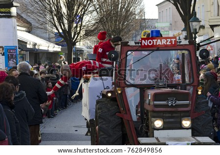 "TULLN, AUSTRIA - FEBRUARY 6, 2016:  float with the topic ""emergency doctor"" at the carnival parade in the year 2016 at Tulln, Austria"