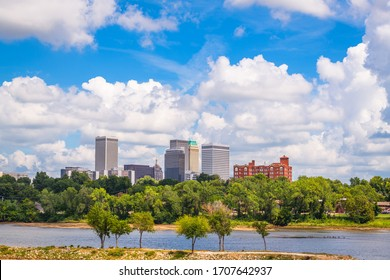 Tulsa, Oklahoma, USA downtown skyline on the Arkansas River in the afternoon.
