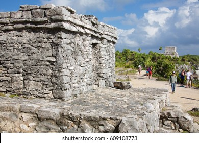 TULUM, MEXICO: DECEMBER 5, 2016: People visiting the Mayan ruins of Tulum, in Tulum Mexico. Tulum was one of the last cities built and inhabited by the Maya.