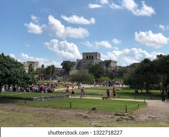 Tulum, Mexico - February 11, 2019: A crowd of tourists visiting the ancient Mayan ruins of Tulum in Mexico