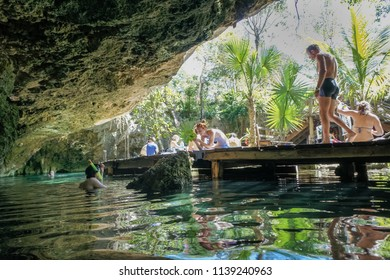 Tulum, Mexico - February, 2014.  People who enjoy Grand Cenote.