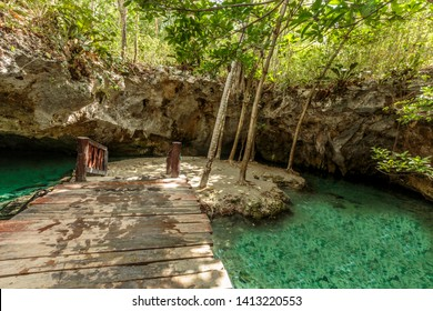 """Tulum, Mexico - May 15, 2019: A natural sink hole known as """"Grand Cenote"""", close to the popular tourist town of Tulum."""