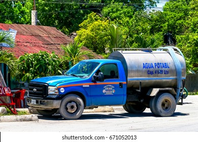 TULUM, MEXICO - MAY 17, 2017: Cistern truck Ford F-550 in the city street.