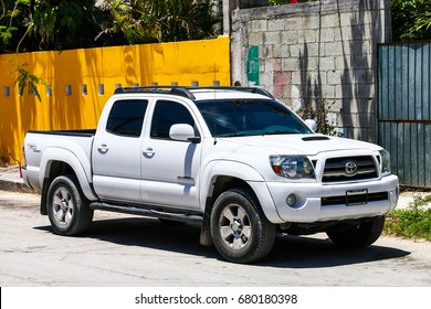 TULUM, MEXICO - MAY 17, 2017: Pickup truck Toyota Tacoma in the city street.