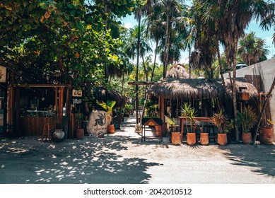 Tulum, Mexico. May 25, 2021. Entrance to the Mur Mur restaurant with counter and sitting arrangement on both side of footpath