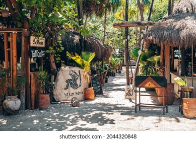 Tulum, Mexico. May 25, 2021. Entrance to the Mur Mur restaurant with name signs and counter along the footpath