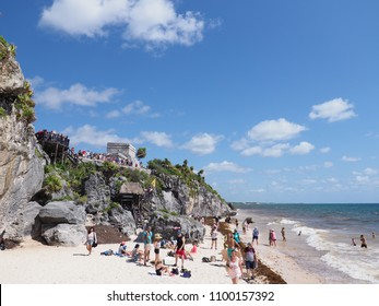 TULUM, MEXICO NORTH AMERICA on MARCH 2018: Panoramic view of ancient ruins of mayan temple god of winds, tourists on beach at mexican city in Quintana Roo with cloudy blue sky in warm sunny winter day
