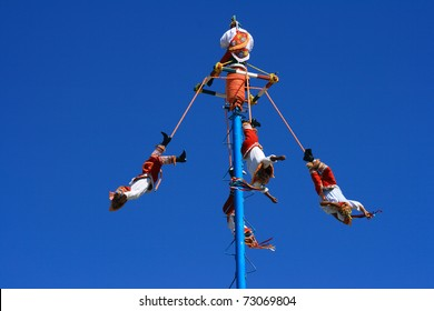 """TULUM -  OCTOBER 23: Daring men from Papantla Veracruz perform the """"Dance of the Flyers"""" a ceremony which is classified as intangible cultural heritage by UNESCO OCTOBER 23, 2006 in TULUM MEXICO"""