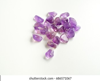 Tumbled Amethyst stones close up for crystal therapy treatments and reiki