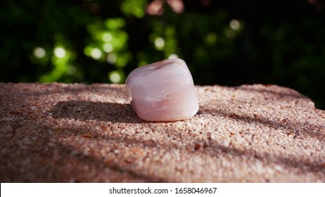 Tumbled Pink Opal Crystal for Heart Chakra in Sun Outside