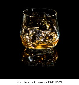 tumbler with scotch for black background