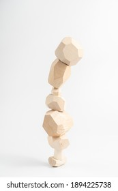 Tumi-ishi puzzle game. The fall of an unstable tower made of multifaceted wood bars. Balance and balance. Stones for Rock Balance.