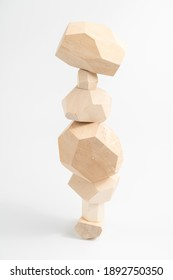 Tumi-ishi puzzle game. Stones for Rock Balance. An unstable tower built from multi-faceted timber bars. Balance and balance.