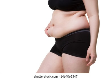 Tummy tuck, flabby skin on a fat belly, plastic surgery concept isolated on white background