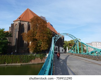 Tumski bridge and Church of Our Lady on Sand in Wroclaw. Poland. Padlock on the bridge.