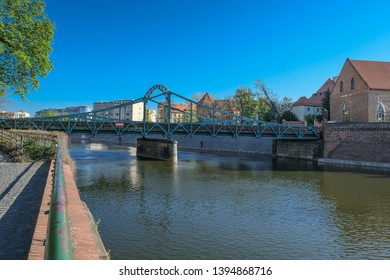 Tumski Bridge, a renovated steel bridge over the north branch of Oder river connecting Tunmski island and Piasek (Sand) Island, full of love locks, Wroclaw, Lower Silesia, Poland - Shutterstock ID 1394868716