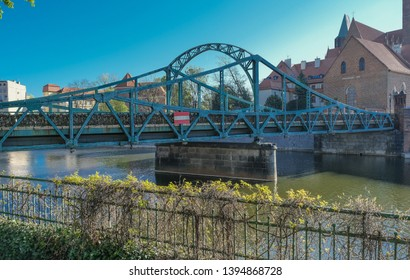 Tumski Bridge, a renovated steel bridge over the north branch of Oder river connecting Tunmski island and Piasek (Sand) Island, full of love locks, Wroclaw, Lower Silesia, Poland - Shutterstock ID 1394868728