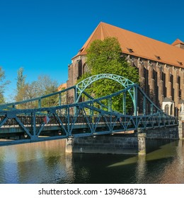 Tumski Bridge, a renovated steel bridge over the north branch of Oder river connecting Tunmski island and Piasek (Sand) Island, full of love locks, Wroclaw, Lower Silesia, Poland - Shutterstock ID 1394868731