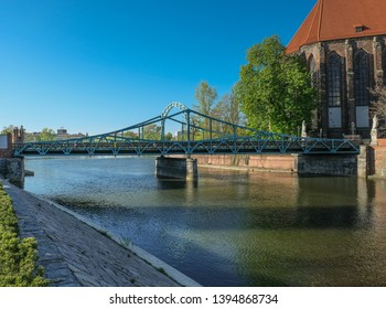 Tumski Bridge, a renovated steel bridge over the north branch of Oder river connecting Tunmski island and Piasek (Sand) Island, full of love locks, Wroclaw, Lower Silesia, Poland - Shutterstock ID 1394868734