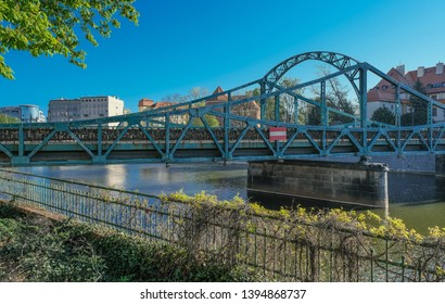 Tumski Bridge, a renovated steel bridge over the north branch of Oder river connecting Tunmski island and Piasek (Sand) Island, full of love locks, Wroclaw, Lower Silesia, Poland - Shutterstock ID 1394868737