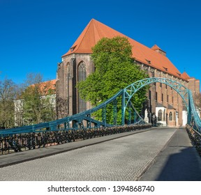 Tumski Bridge, a renovated steel bridge over the north branch of Oder river connecting Tunmski island and Piasek (Sand) Island, full of love locks, Wroclaw, Lower Silesia, Poland - Shutterstock ID 1394868740