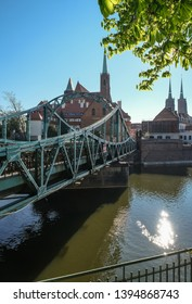 Tumski Bridge, a renovated steel bridge over the north branch of Oder river connecting Tunmski island and Piasek (Sand) Island, full of love locks, Wroclaw, Lower Silesia, Poland - Shutterstock ID 1394868743