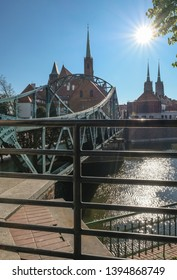 Tumski Bridge, a renovated steel bridge over the north branch of Oder river connecting Tunmski island and Piasek (Sand) Island, full of love locks, Wroclaw, Lower Silesia, Poland - Shutterstock ID 1394868749