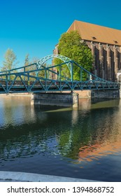 Tumski Bridge, a renovated steel bridge over the north branch of Oder river connecting Tunmski island and Piasek (Sand) Island, full of love locks, Wroclaw, Lower Silesia, Poland - Shutterstock ID 1394868752