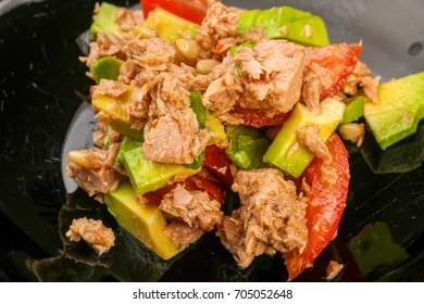 Tuna and avocado salad with tomato served sesame seeds