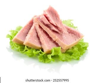 Tuna. Canned fish on green lettuce leaf