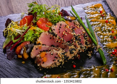 Tuna carpaccio with sauce and spices