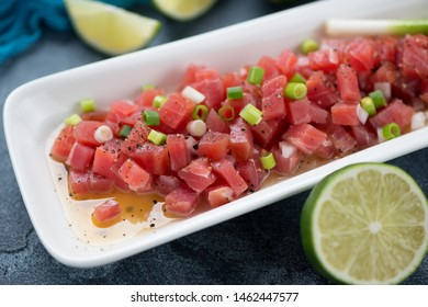 Tuna ceviche or raw tuna fillet marinated in a lime juice, selective focus, close-up