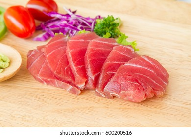 tuna fish on wood with vegetable