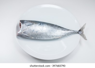 Tuna fish raw on white dish on white background