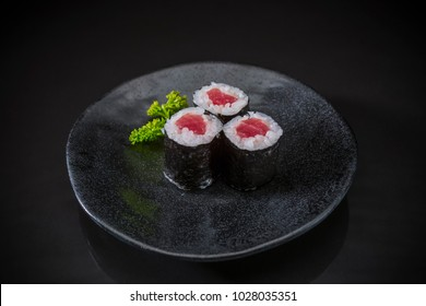 Tuna Maki Roll served on traditional Japanese food on ceramic dish, Japanese food style, Sushi Menu, raw tuna sushi maki roll on black dish, selective focus