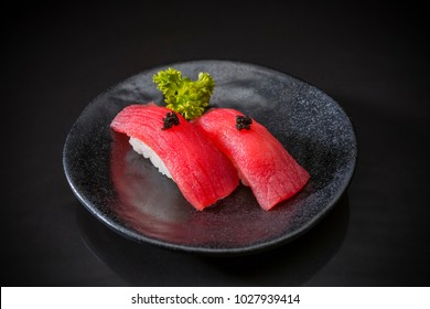 Tuna Nigiri, Sushi Tuna, Japanese food on ceramic dish, Japanese food style, Japanese menu, sushi tuna, maguro sushi on dish background, selective focus