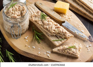 Tuna pate with egg, cheese in a jar and crispy bread. Fish rillette, healthy snack, diet food