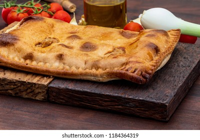 Tuna pie. Typical Galician dish (Galicia) and Spain. With natural ingredients such as tomato, onion, pepper, eggplant, tuna, boiled egg, wheat and vegetable oil. Fish and vegetables cake.