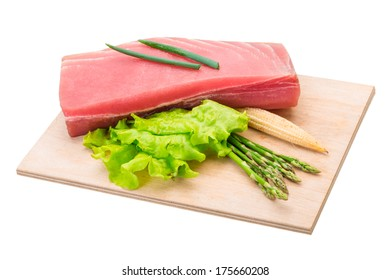 Tuna raw steak with asparagus and salad