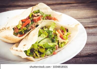 tuna salad pita sandwich closeup dish
