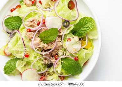 Tuna salad and vegetable with lettuce, eggs and pomegranate isolated on white background.