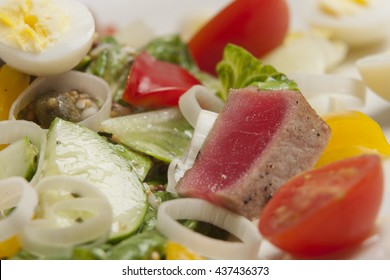 Tuna salad with vegetables and quail eggs